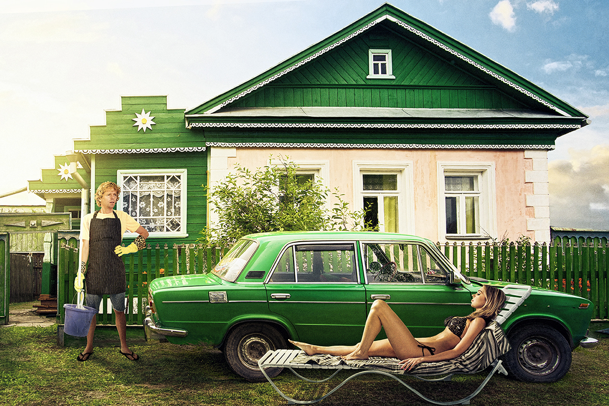 The picture of typical old-fashioned house on the roads of Russia